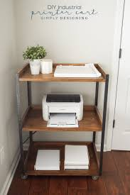 industrial diy printer table with three shelves and caster wheels holding paper printer paper