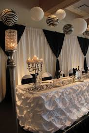 Black and white head table Decor provided by Aglow Bridal Lounge  www.AglowBridalLounge.com