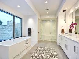 modern master bathroom with frameless shower mosaic tile and hanging small lamps also brown rug then modern e24 bathroom
