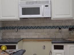 kitchen backsplash white subway tile with blue accent