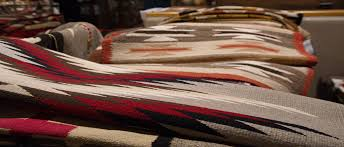 jackson clark sr the founder of toh atin gallery began trading in navajo rugs in 1957 toh atin is proud to have one of the finest selections in the