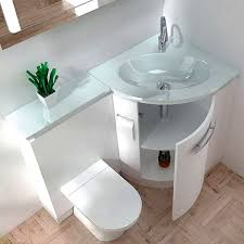 a sink with a storage space and counter and a toilet in one unit