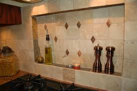 built in tile niches above the stove add both visual interest and functionality