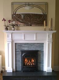 we installed new quarter tiles on the face of this old fireplace and installed a president gas insert to bring the fireplace back to life and add extra