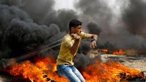 Image result for Gaza protesters attacking the Israeli fence