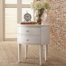 This beautifully crafted table has a curved apron, tapered legs and an  edge-rubbed finish. These add to the inherent beauty of this Neo Oval  Nightstand Set ...