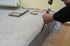 removing wall tile adhesive
