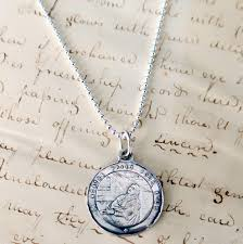 st agatha etched medal patron of nurses and against t cancer sterling silver antique replica