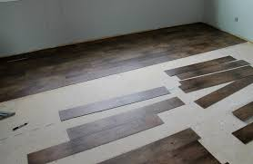 step 3 set up your stagger by cutting the vinyl planks with your utility knife you don t want the flooring to look like steps going through the flooring