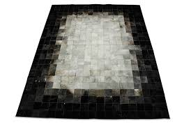 white gray and black patchwork cowhide rug in squares