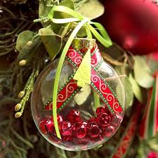 jingle bell filled clear glass ornament