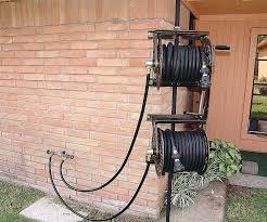 decorative garden hose holder wall mount decorative garden hose containers garden hose holder metal hose holder