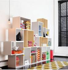 above designed by belgian dane julien de smedt of jds architects for muuto the stacked shelf system allows you to create a shelving unit customized to any