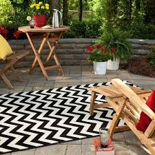 attractive black white rugs furnitures for outdoor living space as well flower garden in the near