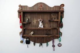 rustic wood medal holding shelf wall