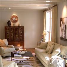 magnificent high ceiling living room with white leather sofa and square black coffee table on animal print rug also cream curtain idea
