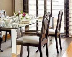 ... Glass top dining table with wooden chairs