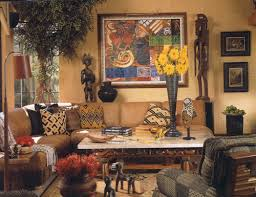 Here colorful African prints on pillows accent a couch with clean lines and  the intricately carved