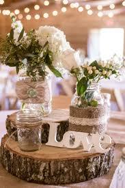 Rustic wedding table top centerpieces idea using mason jars, burlap, lace  and beautiful flowers