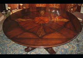 round dining table with self storing leaves round dining room