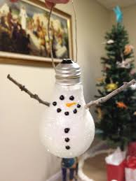 DIY Ornaments - Lightbulb Snowman, my mom made these w/my kids on year,  great reuse/recycle ornament.if you can still find these bulbs before  completely ...