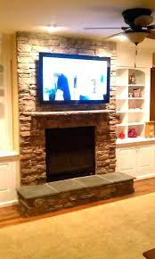 what to hang over fireplace ideas ceiling hung electric fireplace