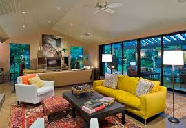 Traditional carpet with yellow couch