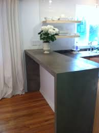2 of 5 parson's style breakfast bar made out of layered plywood with an  Ardex concrete