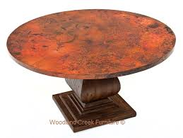 round copper table heavy wood pedestal base