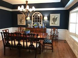 my dining room with sherwin williams naval paint color blue and white pottery and antique triple settee
