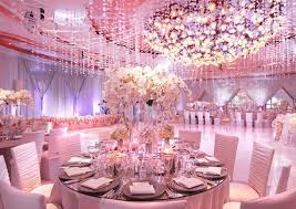 pink wedding party decorations with large round tables and small chairs also white flower table centerpiece