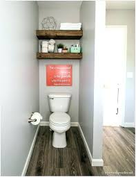 floating shelves over toilet above ideas