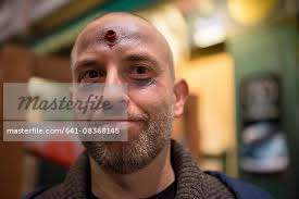 bald people with gothic makeup google search bearded man fake shot in his forehead at stock