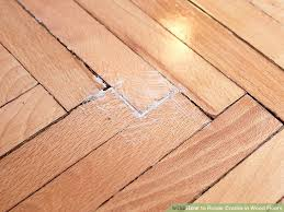 fill cracks in wood floor with sawdust