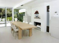 white lux dining room area with long dining table and white chair and the storage tips on renovating a house to modern style other design ideas