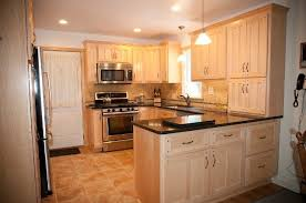 kitchen with wood cabinets and granite countertop capital stone saratoga in saratoga springs ny