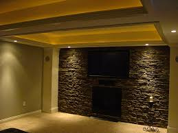 faux stone wall panels with fireplace and light for home decoration ideas