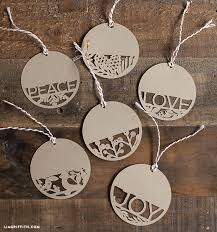 You can edit different aspects of this customizable template including text, imagery. Paper Cut Holiday Gift Tags Lia Griffith