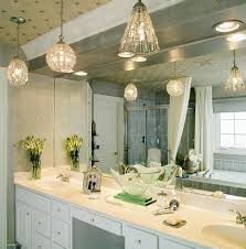 stylish crystal pendant lighting fixtures for bathroom over a white counter and sink