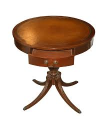 furniture round brown wooden table with with single drawer and four curving wooden legs on