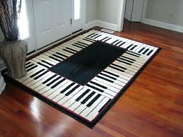 this piano keyboard rug would look nice in a teaching studio note area all