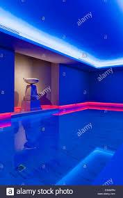 indoor pool lighting. Neon Red Lighting In Indoor Home Swimming Pool - Stock Image H