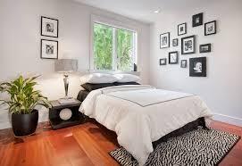 Small Single Bedroom Laminate Flooring Beside White Wooden Shelves Small Bedrooms