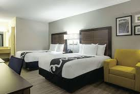 a bed or beds in a room at la quinta inn by wyndham west palm beach
