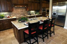 kitchen colors dark cabinets large marble topped island with dining space centers this kitchen over beige tile flooring with kitchen wall color ideas with