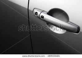 door handle of a car or door opener with unlock on and key insert hole