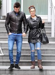 the matching couple dan hooper and kym marsh wear leather jackets and blue jeans for