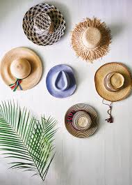 clever ways to use hats as wall decor