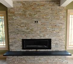 stone tile fireplace in living room