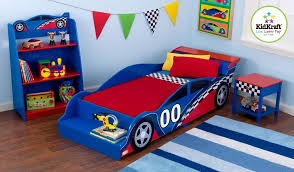 stunning cars bedroom decor with race car shape bed and red bedding sets also stripes blue rug on brown laminate wooden floor plus open plan shelves